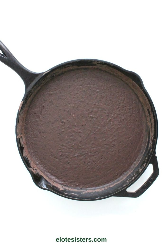 refried black beans in cast iron skillet