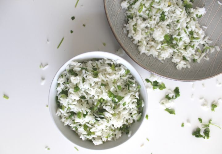 bowl of cilantro lime rice and plate of the same off to the right top corner on white background