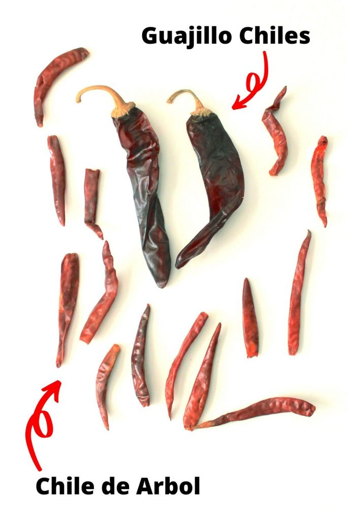 guajillo and chiles de arbol in a white background with text pointing to them