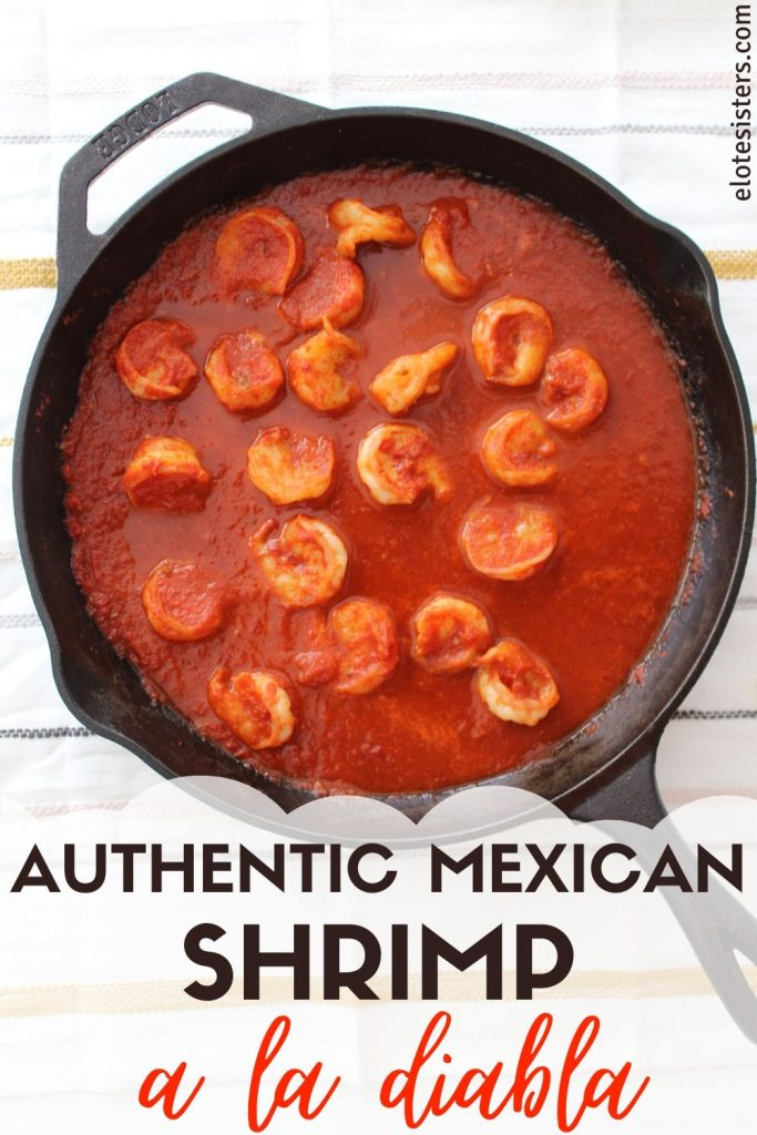 shrimp in red sauce in a black skillet